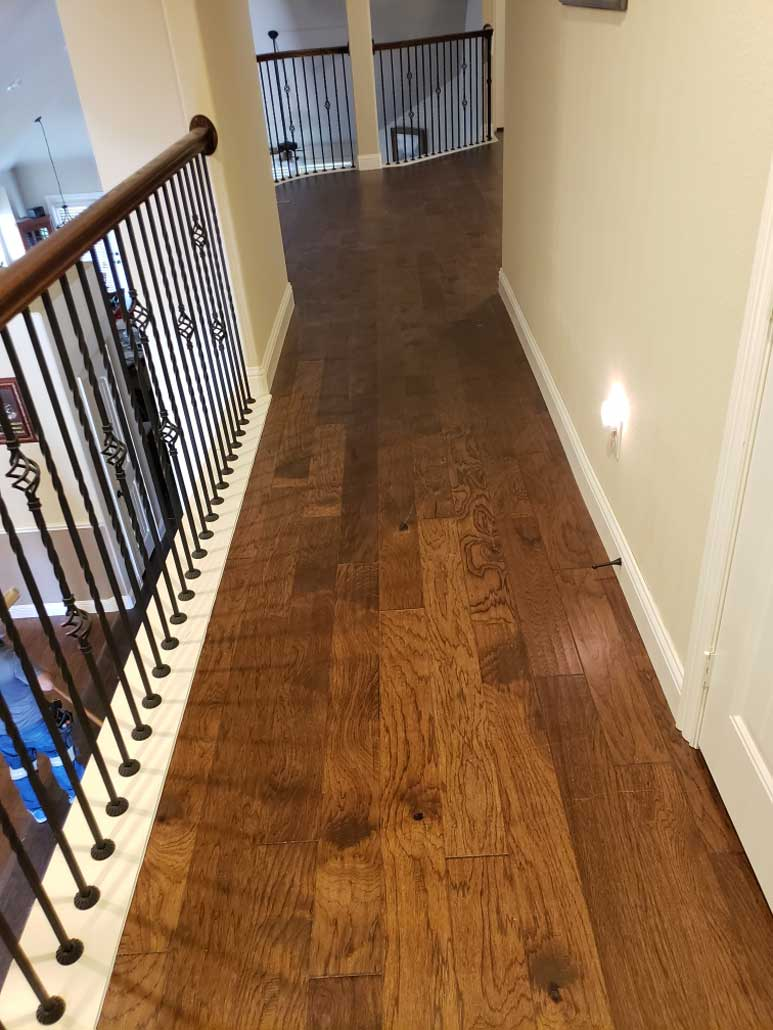 Engineered Wood with Baseboards Upstairs